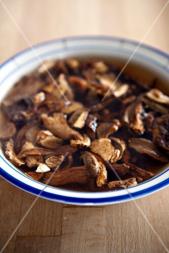 Dried porcini mushrooms being softened in water