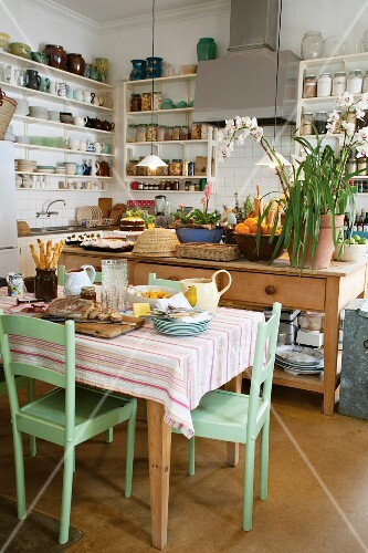 A kitchen-diner in the country with preparations for a meal