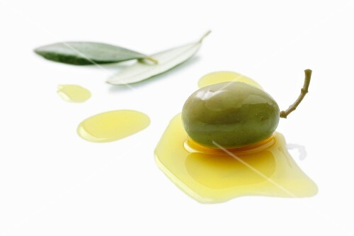 An olive in a pool of olive oil