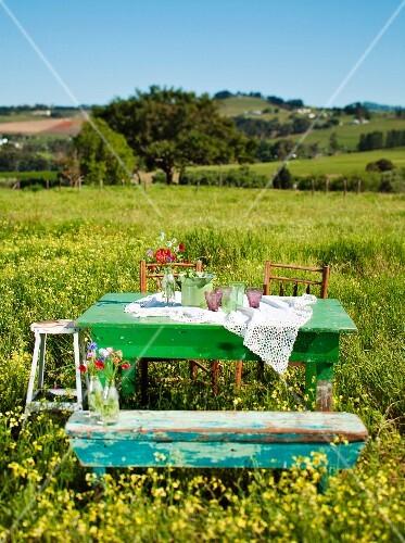 Garden furniture in a field of blooming rape