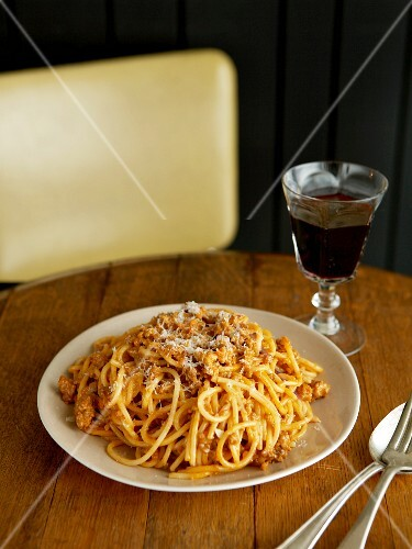 Pasta Bolognese with a Glass of Red Wine