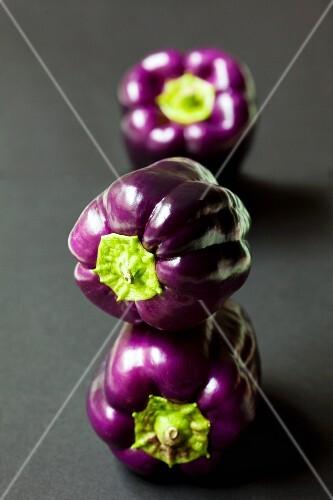 Three purple peppers