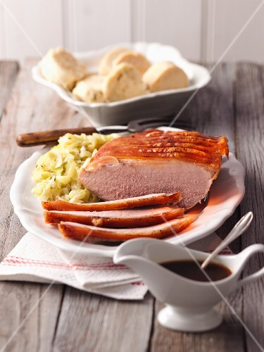 Crispy roast pork with a cabbage medley and napkin dumplings