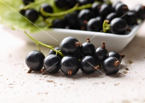 Blackberries, some in a dish