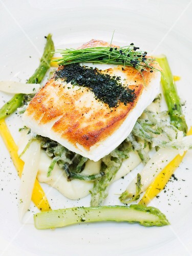 Fried halibut with pepper and asparagus on mashed potatoes