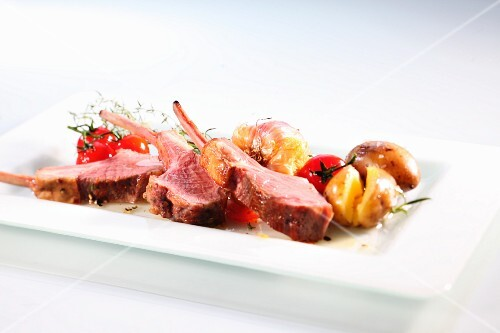 Lamb chops with roast potatoes and cherry tomatoes