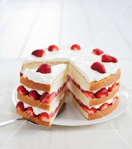 Layered Strawberry and Cream Cake; Slice Removed