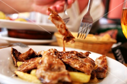Fried veal strips with fried potatoes