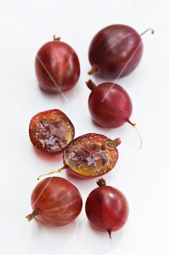 Red gooseberries, one halved