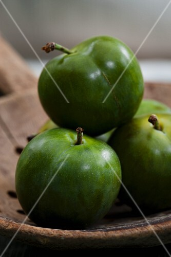 Greengages on an old wooden ladle