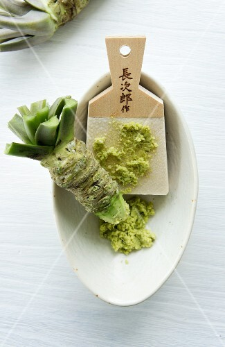 A wasabi root and a traditional grater made of whale skin