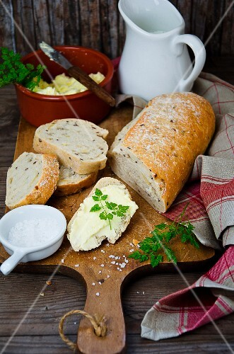 Fresh bread with butter and salt