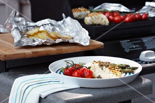Grilled halibut with vine tomatoes and baked potatoes