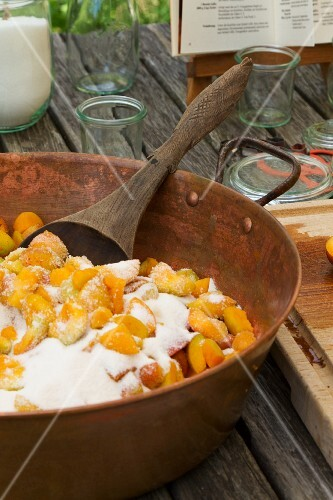 Apricot jam being made: Sugared apricots in a pot