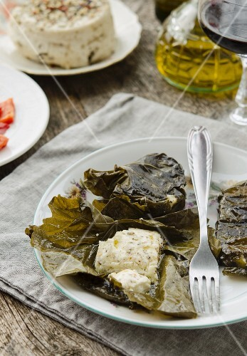 Grilled cheese wrapped in vine leaves