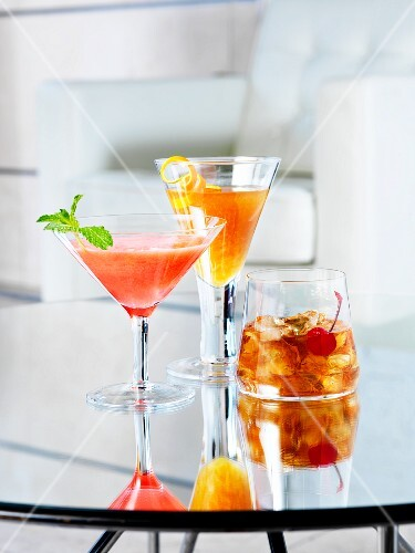 Various cocktails on a glass table