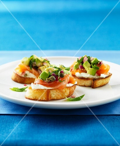 Bruschetta topped with smoked salmon, capers, mint and avocado