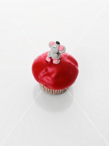 A cupcake decorated with an elephant