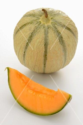A whole cantaloupe melon and a wedge