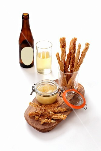 Cheese sticks with apple sauce and apple wine