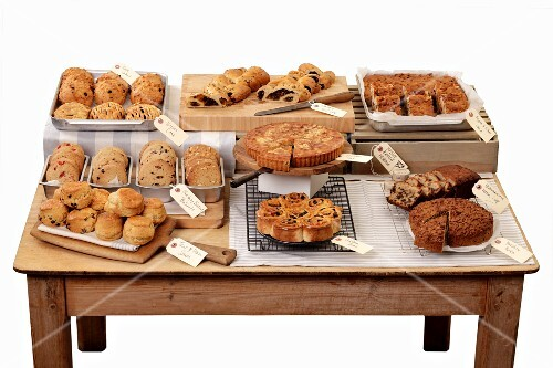 A cake buffet on a wooden table