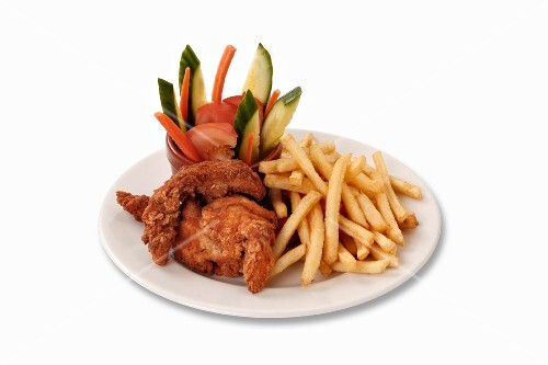 Chicken nuggets with chips and vegetables