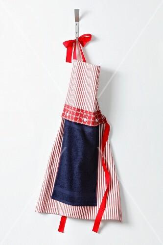 An apron handing on a hook
