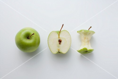 A whole apple, half an apple and an apple core