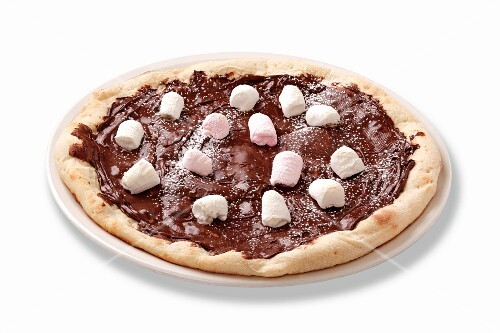 A chocolate pizza topped with marshmallows