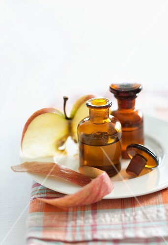 Scented apple oil and a slice of apple
