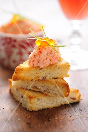 Canapes with salmon rillette and caviar