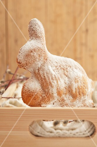 A baked Easter bunny dusted with icing sugar