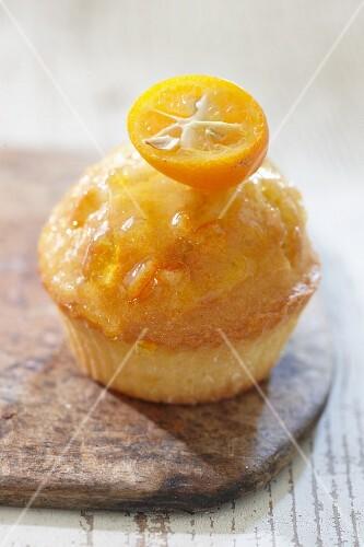 An orange muffin with kumquat