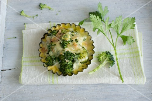 Broccoli with garlic, topped with cheese and baked