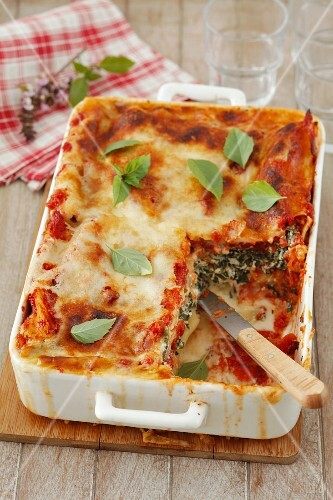 Cannelloni with spinach and ricotta in a tomato and Bechamel sauce