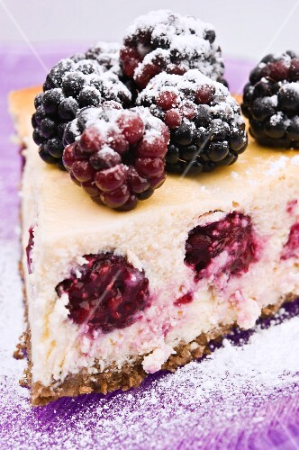 A slice of cheesecake with blackberries (close-up)