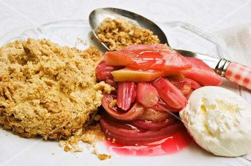 Rhubarb crumble with mascarpone cream on a plate