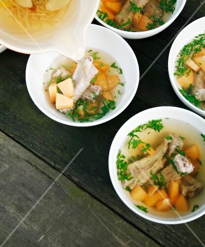 Broth with bamboo mushrooms, melon and pork ribs