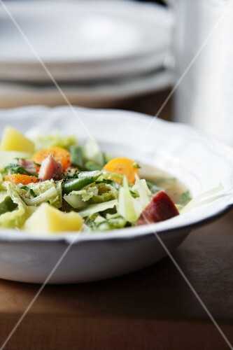 Vegetable soup with bacon and white cabbage