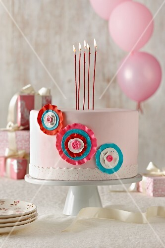 Pink Birthday Cake with Tall Lit Candles