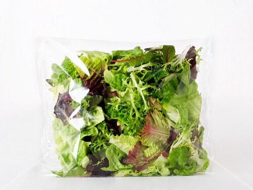 Mixed green salad in a plastic bag