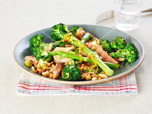 Smoked salmon trout with broccoli, nuts and orange zest