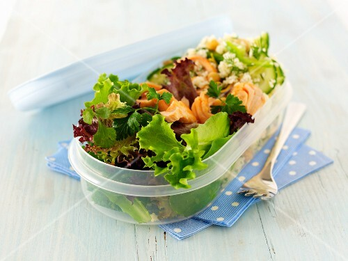Salmon and couscous salad in a oval Tupperware box