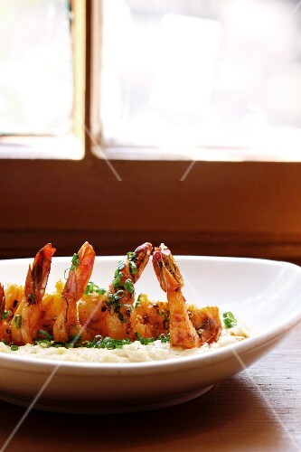 Sauteed Shrimp on Stone Ground White Grits Served with Spicy Tasso Sherry Cream