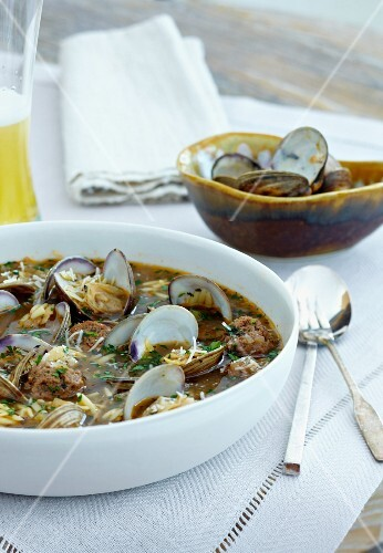 Bowl of Clam Soup with Orzo and Meatballs