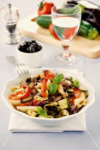Penne pasta with vegetables and basil