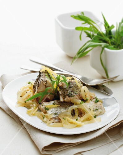 Marinated carp with onions
