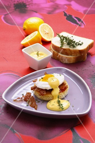 Eggs Benedict with bacon and sauce Hollandaise