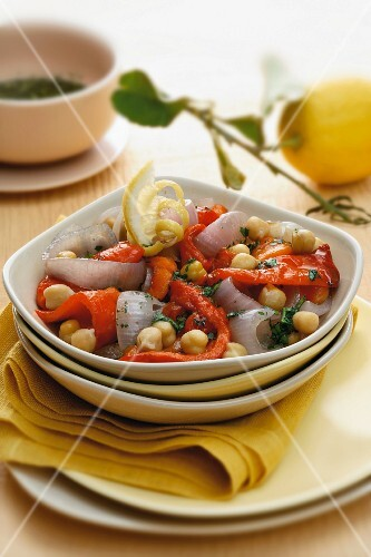 Vegetable salad with peppers, onions, cherry tomatoes and lemon