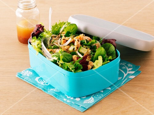 Mixed leaf salad with salmon in a lunchbox